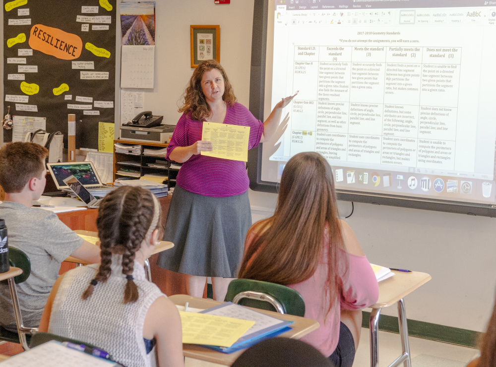 Amanda Boyce teaches honors geometry Thursday at Winthrop High School. Winthrop High School will be participating in a regional program to train math coaches, a collaborative project that will benefit teachers at the school.