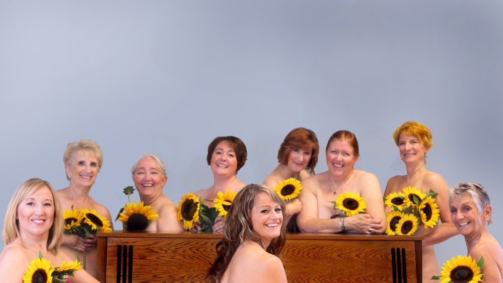 """Calendar Girls"" from left are Jamie Sayers, Ginger Smith, Teresa Rael, Pam Smith, Kalyn Black, Juli Brooks, Doree Austin, Lisa St. Hilaire and Tina Wentzel."