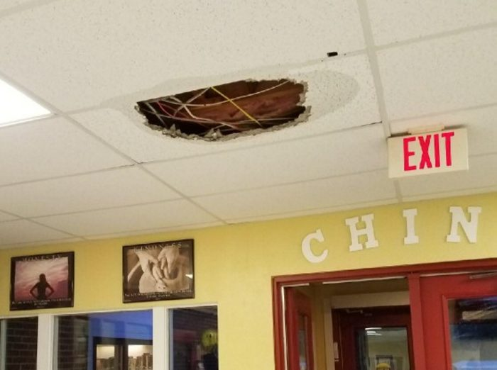Water damage is seen on the ceiling inside China Middle School after heavy rain on Tuesday caused flooding inside the building.