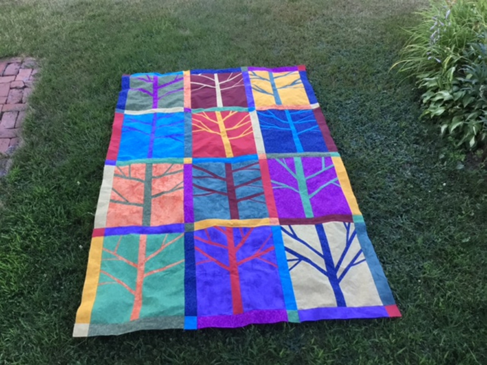 The handmade quilt, made by the Seam Rippers of South China, will be raffled Oct. 16. Proceeds will benefit the Permaculture Project at Vile Arboretum.