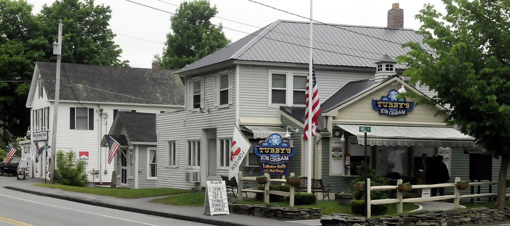 The Wayne village center, featuring the Wayne General Store, left, and Tubby's Ice Cream on Route 133, soon will see signs and lights that advertise the need to slow down and watch for pedestrians, thanks to grant funding from AARP.