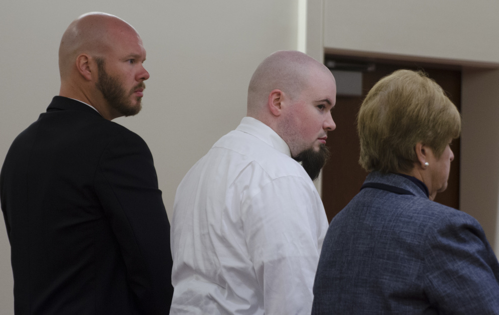 Leroy Smith III, center, stands Monday with his attorneys, Scott Hess, left, and Pamela Ames right, after he entered a plea of guilty, but not criminally responsible, to manslaughter in the death of his father.
