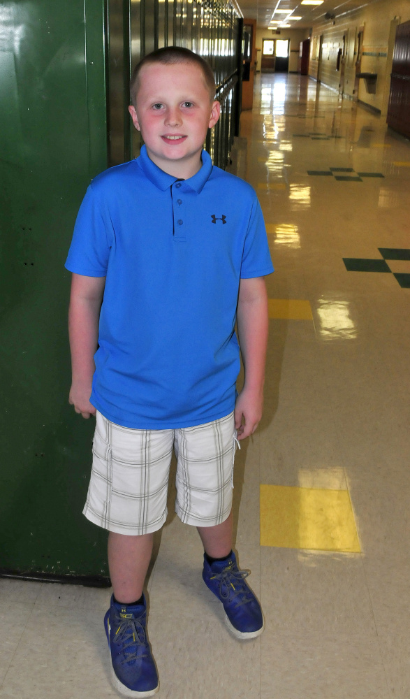 Dillon Whitney of Burnham, pictured in the hallway of Warsaw Middle School in Pittsfield on Monday, raised almost $400 selling soft drinks and snacks at the Clinton Lions Agricultural Fair recently to donate to hurricane relief efforts through the Red Cross.