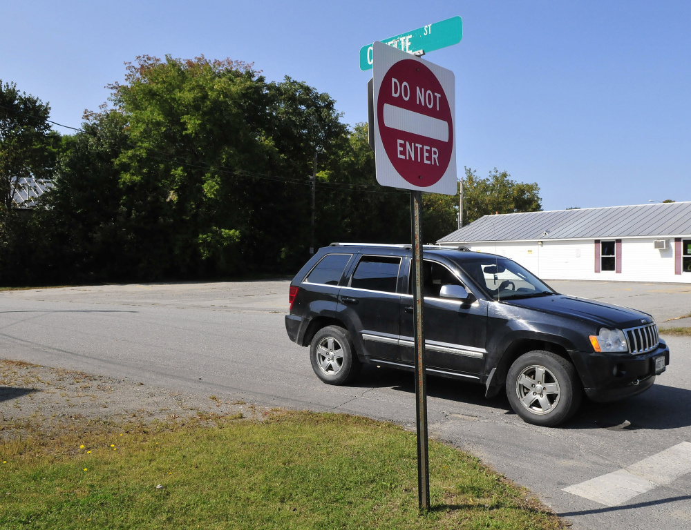A vehicle pulls out from the one-way Cowette Street on to North Street in Skowhegan on Monday.