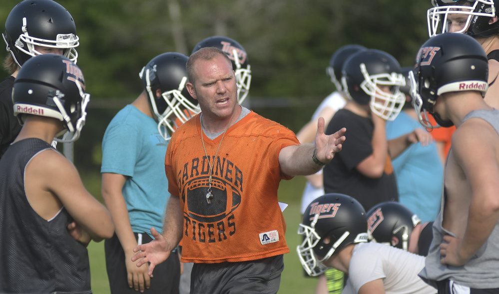 Gardiner football coach Joe White talks to his team during the first day of fall sports practice Aug. 14 in Gardiner.