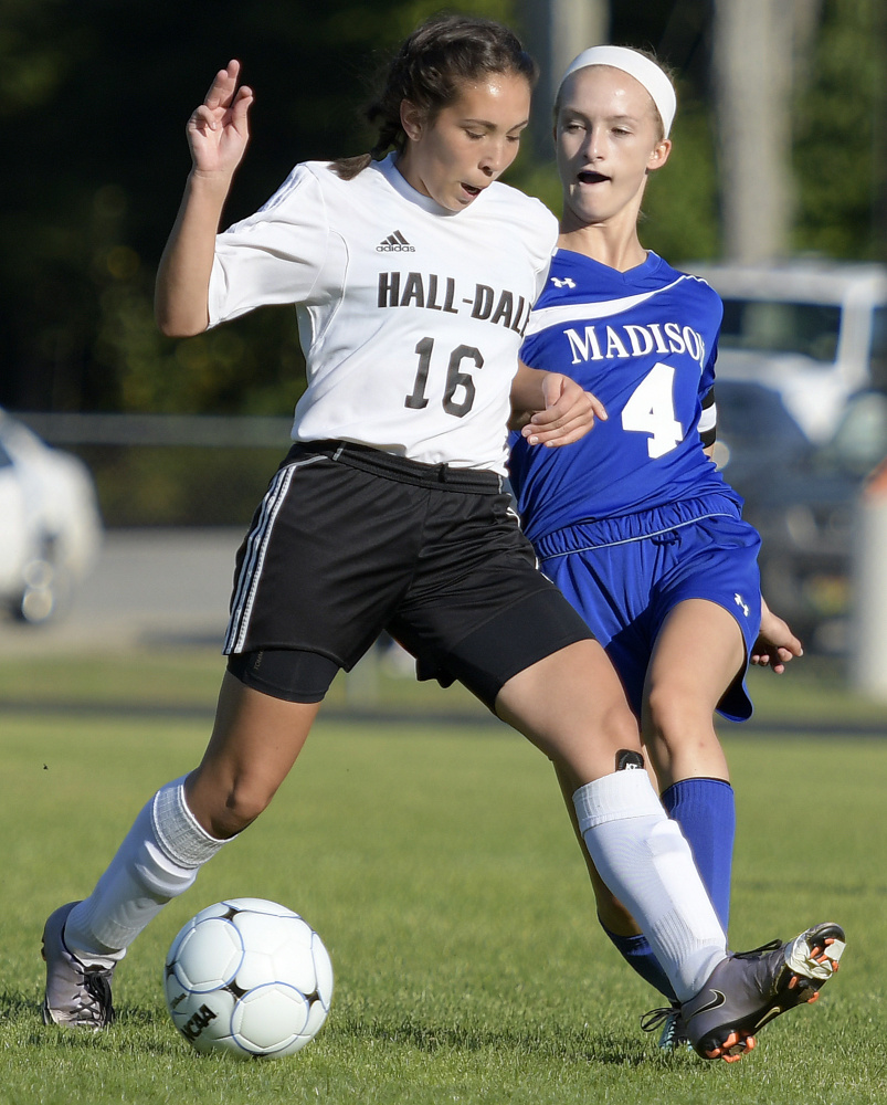 Madison senior Whitney Bess, right, tries to stop Hall-Dale senior Isabelle Martinez during a Mountain Valley Conference game Tuesday afternoon in Farmingdale.