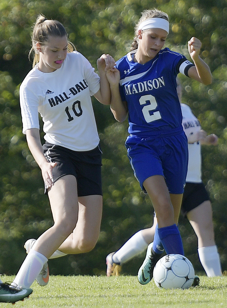 Madison senior Jillian Holden, right, and Hall-Dale freshman Olivia Bourque make contact during a Mountain Valley Conference game Tuesday afternoon in Farmingdale.