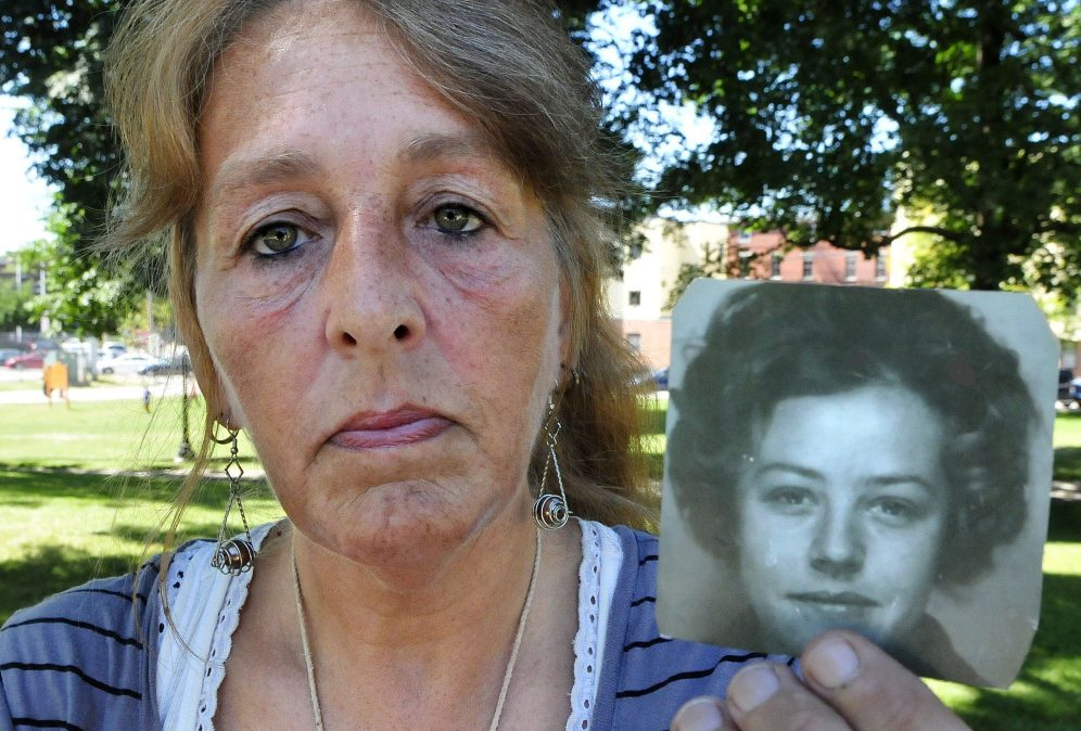 Honey Rourke, of Lewiston, holds a 1970 photograph of her mother, Pauline Rourke, on July 26. Pauline Rourke disappeared in 1976 and is believed to have been murdered by Albert Cochran, who died recently in prison.