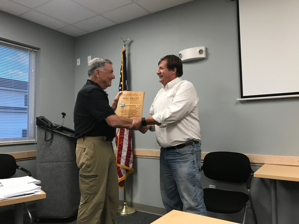 Mike Willey. left, accepts a symbolic key to the town of Oakland on Wednesday night from Town Council Chairman Michael Perkins.