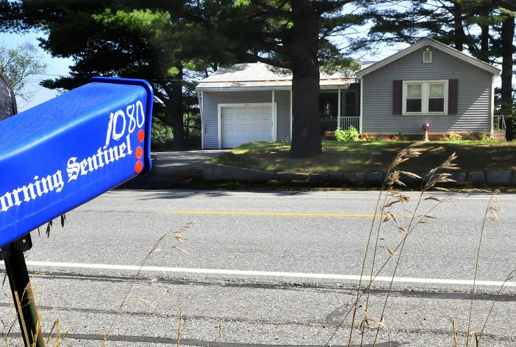 The home of Charles Atwood is seen across the street from his mailbox and newspaper tube Thursday on U.S. Route 201 in Skowhegan. Atwood died after getting struck by a box truck early Tuesday morning while crossing the roadway.
