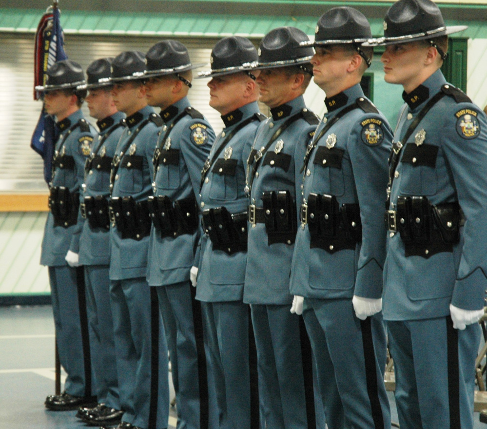 The eight state troopers who graduated on Friday from the Maine Criminal Justice Academy in Vassalboro now will ride with senior troopers before patrolling on their own.
