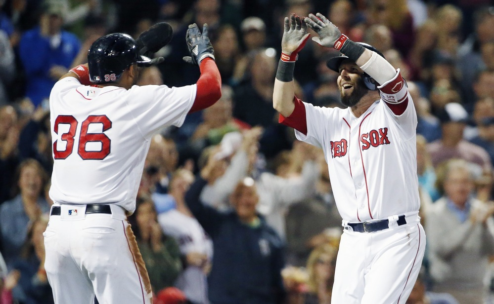 Boston second baseman Dustin Pedroia, right, celebrates his two-run home run that also scored Eduardo Nunez during the first inning of a game last Saturday.