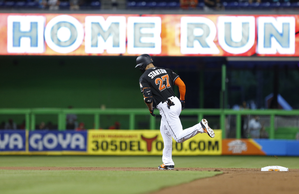Miami Marlins slugger Giancarlo Stanton rounds second base after hitting a home run during the first inning of a Sept. 2 game against the Phillies in Miami.