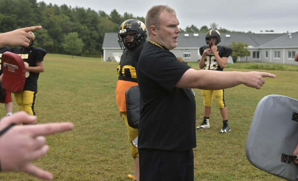 Maranacook football coach Walter Polky directs his team at practice Wednesday in Readfield.