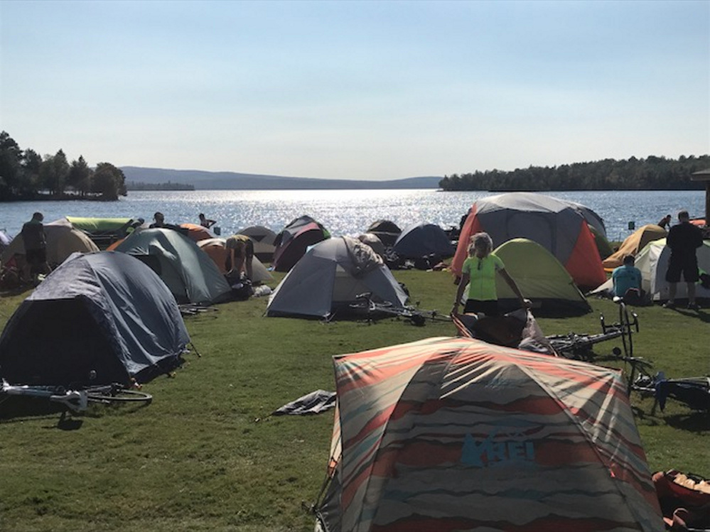 Participants in the 2017 BikeMaine event set up tents in Rangeley's Town Park during a three-day layover.