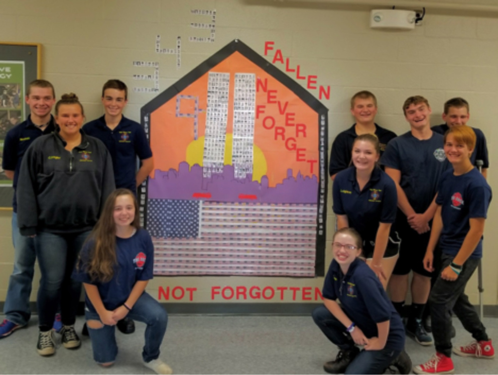 Firefighter class, left side of tribute, are Christina Smedberg, kneeling; in back, from left are Tyler Noonan, Coby Dangler and Jared Goss. On the right side of tribute are McKinley Lynn Carignan, kneeling; in the middle, from left are Ashley Leighton and AJ Maroney; and in back, from left are Zac Campbell, Joe Libby-Cornette and Kevin Trask.