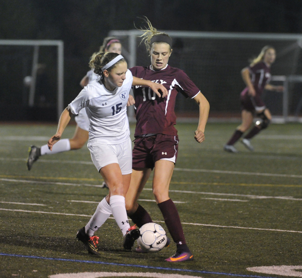 YARMOUTH, ME - OCTOBER 17: Yarmouth vs. Greely girls soccer game. Yarmouth's #15, Cory Langenbach, vies with Greely's #10, Courtney Sullivan, for control of the ball. (Photo by John Ewing/Staff Photographer)