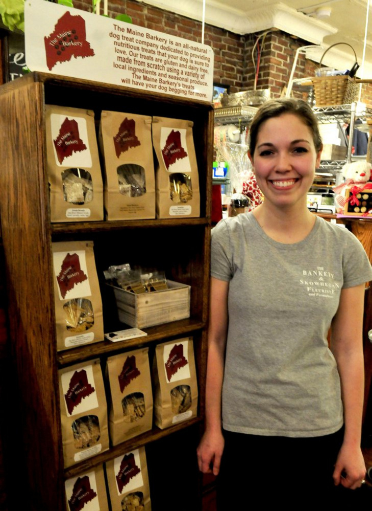 Amanda Clark is seen in February 2016 beside some of the products made by her company, The Maine Barkery. Clark was the first winner of the Entrepreneur Challenge in 2016. After a year she closed her storefront in Skowhegan and moved her business to Smithfield, where she is concentrating successfully on wholesaling her products.