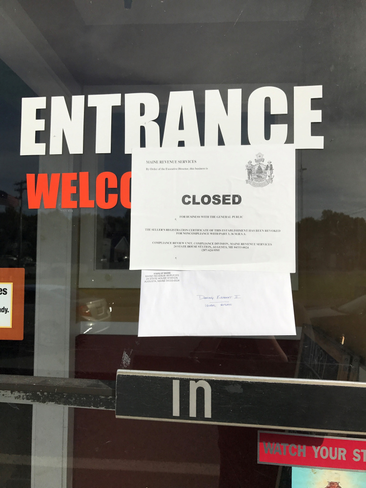 A sign on the front door of the Dancing Elephant II states that the restaurant was closed to business with the public by the Maine Revenue Service for noncompliance with tax requirements.