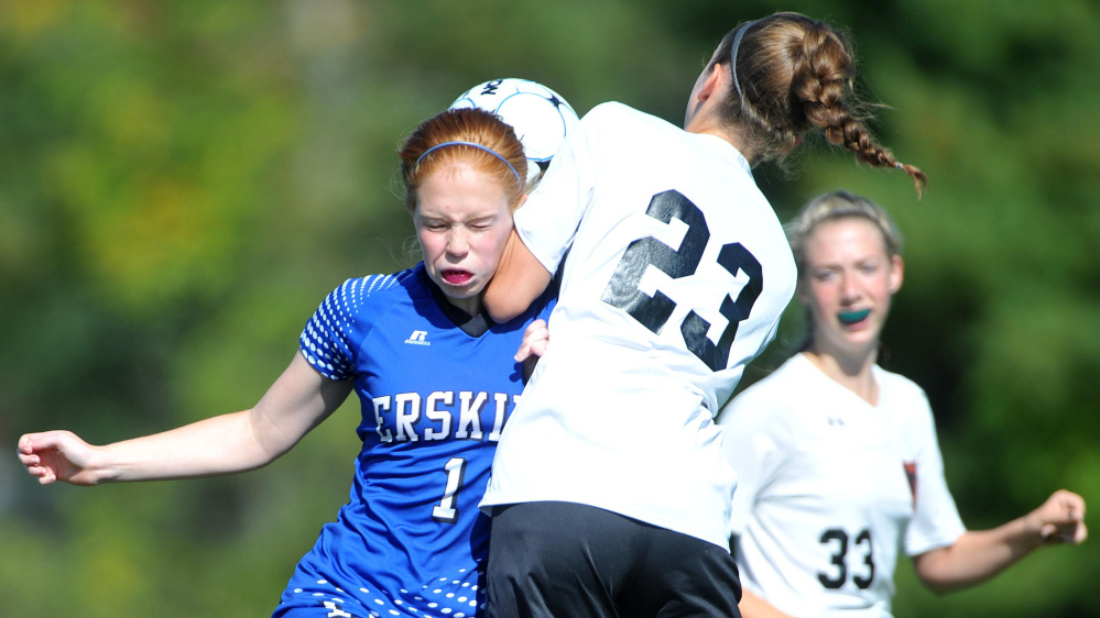 Erskine Academy's Summer Hotham (1) collides with Winslow High School's Meaghan Bernard (23) right, on Saturday at Kennebec Savings Bank Field in Winslow.