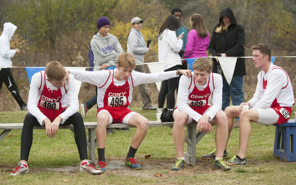 Cony's Alex Farkas, Myles Quirion, Aaron Emerson and Jack Wroten rest after the Class A boys Northern regional cross country championship last season in Belfast. The Rams are off to a good start this season.