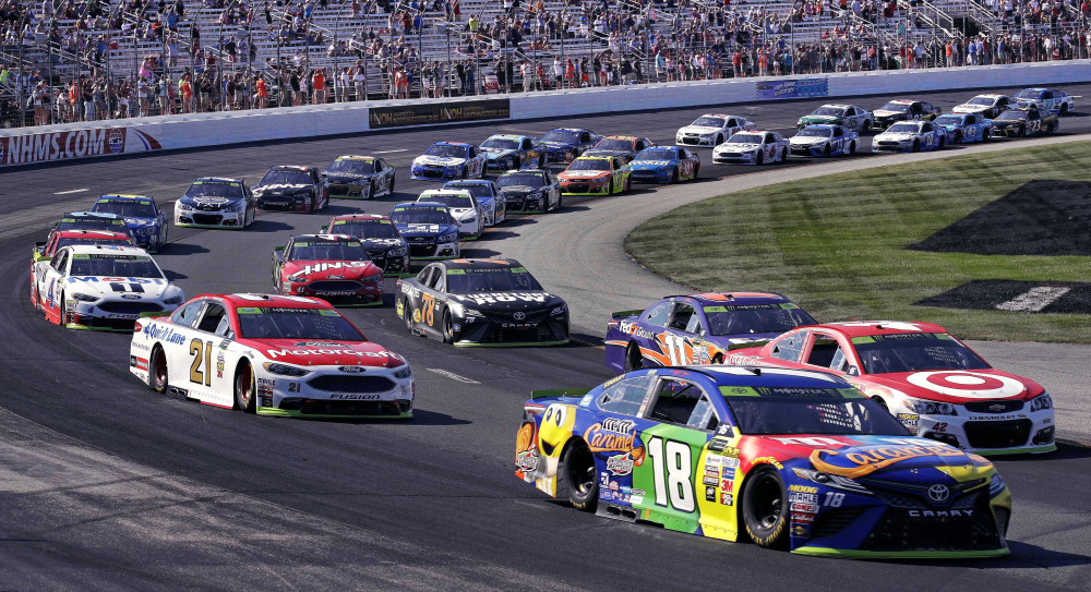 Kyle Busch (18) leads the pack into turn one in the first lap of the NASCAR Cup Series 300 race at New Hampshire Motor Speedway on Sunday in Loudon, New Hampshire. Busch won the race.