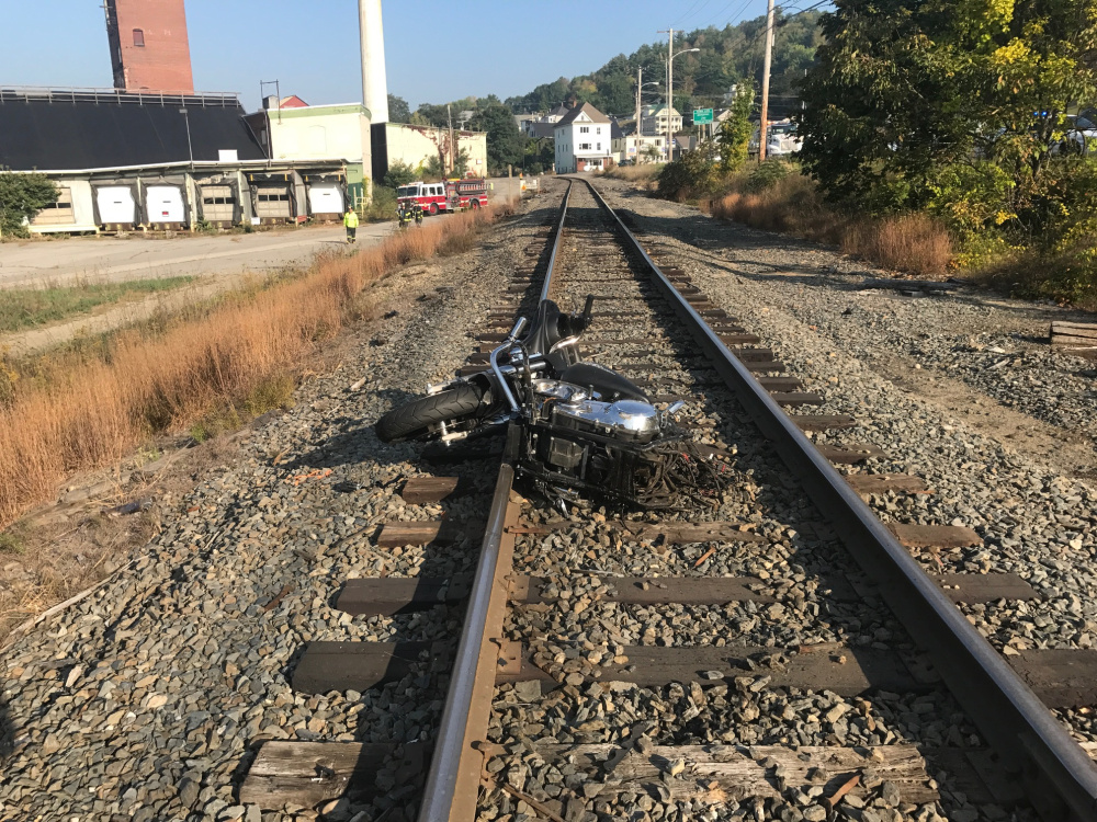 The front end of Breanne Hewins' motorcycle lies on railroad tracks after it was split in two hitting a utility pole.