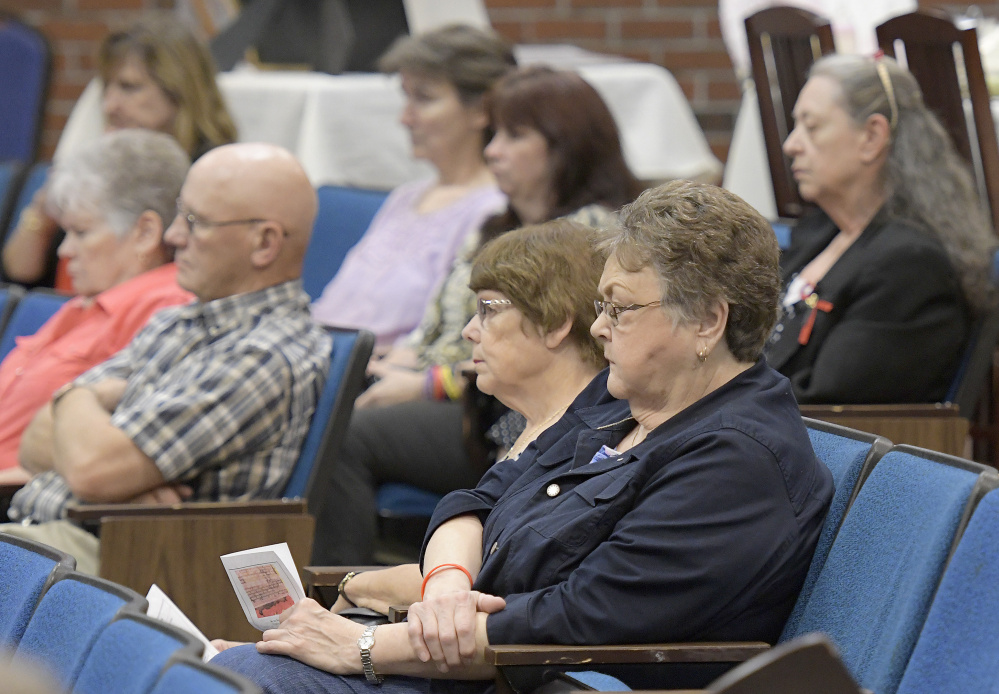 Families of homicide victims listen to speeches Monday during the Maine Day of Remembrance for Murder Victims in Augusta.
