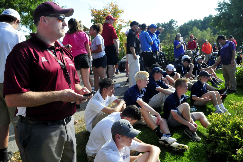 Nokomis golf coach Matt Brown waits with players from area schools for results of the Kennebec Valley Athletic Conference qualifier Tuesday at Natanis Golf Course in Vassalboro.