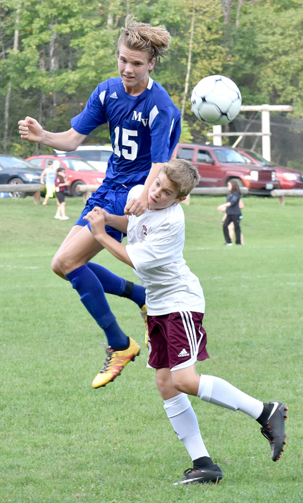 Mountain Valley's Espen Lamberg (15) out-leaps Monmouth's Cody Michaud for a header during a Mountain Valley Conference game Tuesday in Monmouth.