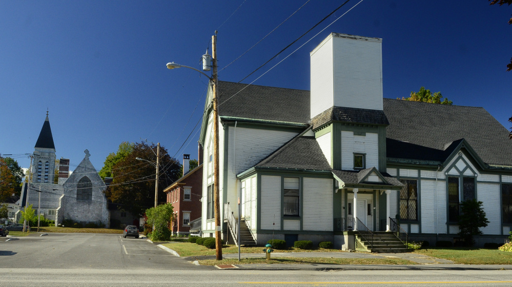 The former St. Mark's Episcopal church, left, stands west of the former Elim church, which is on the northwest corner of Oak and State streets in Augusta.