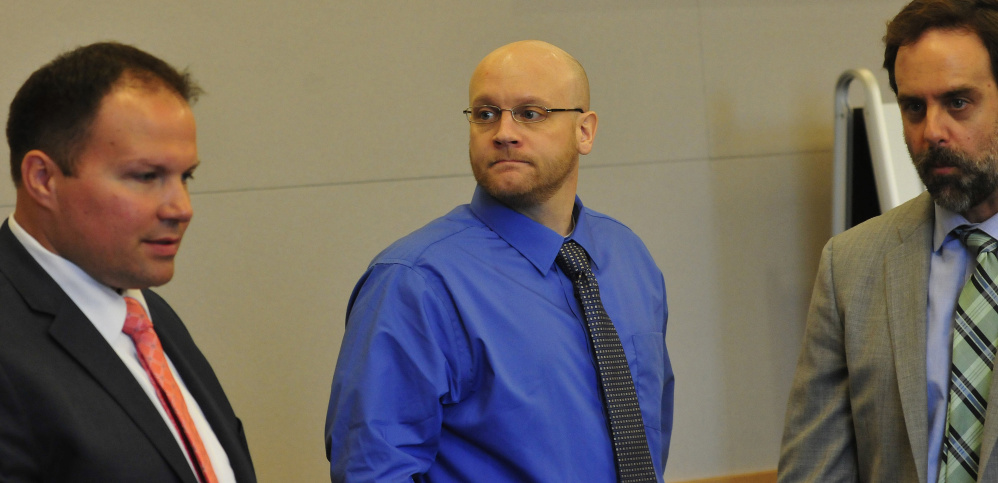 Defendant Robert Burton, center, is flanked by his defense attorneys, Zachary Brandmeir, left, and Hunter Tzovarras, on Monday, the first day of his murder trial in the slaying of Stephanie Gebo. On Friday, the defense suggested the Maine State Police rushed to judgment in charging Burton with murder when evidence admitted in the trial had yet to be collected.