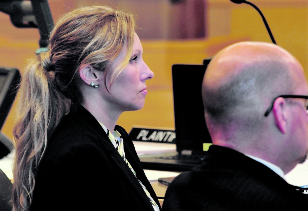 State police Detective Jennifer Fiske sits next to Assistant Attorney General Donald Macomber during the Robert Burton murder trial this week at Penobscot Superior Court in Bangor. Fiske took the stand on Friday.