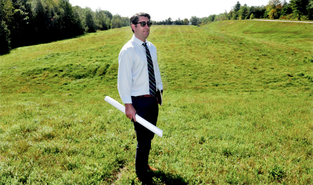 Garvan Donegan, of the Central Maine Growth Council, has worked with the town of Fairfield and Gizos Energy on a solar energy project planned for the town's closed landfill on Eskelund Drive, where the sun shone brightly Wednesday.