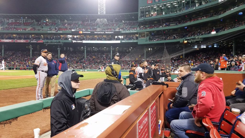 "In this photo provided by Avi Miller, security watches after Baltimore Orioles center fielder Adam Jones was taunted by racial slurs at Fenway Park in Boston, Monday, May 1, 2017. Boston Red Sox President Sam Kennedy apologized to Jones Tuesday, May 2, 2017. Massachusetts Gov. Charlie Baker, in a tweet the same day, called the behavior by fans ""unacceptable and shameful."""