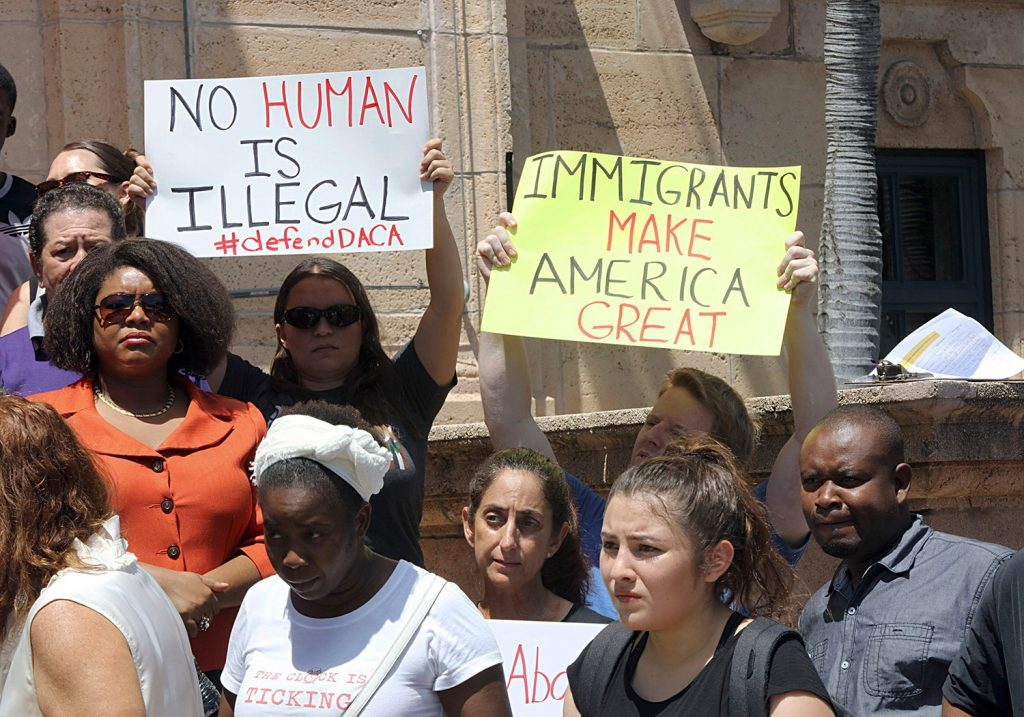 A group rallies in Miami  Tuesday to defend the Deferred Action for Childhood Arrivals program. President Trump began dismantling the DACA program, which protects hundreds of thousands of young immigrants who were brought into the country illegally as children.