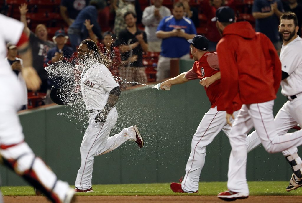 Hanley Ramirez is sprayed with water and chased by Red Sox teammates after driving in the winning run with a single in the 19th inning for a 3-2 victory over the Toronto Blue Jays early Wednesday morning.