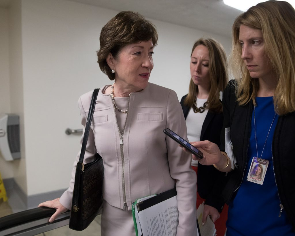 Sen. Susan Collins, R-Maine, speaks with a reporter as she arrives for a vote at the Capitol on Tuesday. In a Senate floor speech, she beseeched her colleagues to work toward a bipartisan compromise on repairing the Affordable Care Act.