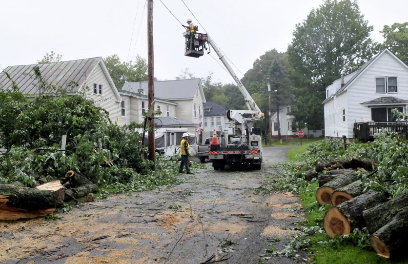 Workers with Spectrum repair cable lines Wednesday morning after a large limb from a maple tree toppled cable and phone lines and damaged property on both sides of Preble Street in Fairfield during a storm Tuesday evening. Fairfield Public Works crew helped with the cleanup.