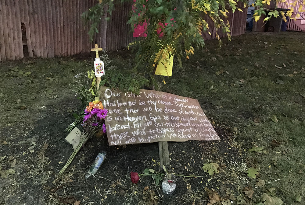 A memorial to Sharon Crawford was set up at the intersection of Stroudwater Street and William Clarke Drive on Wednesday, a day after Crawford was hit by a vehicle and killed at the intersection.
