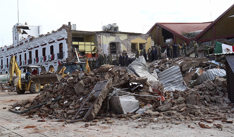 Soldiers remove debris from a partly collapsed municipal building after an earthquake in Juchitan, Oaxaca state, Mexico on Friday.