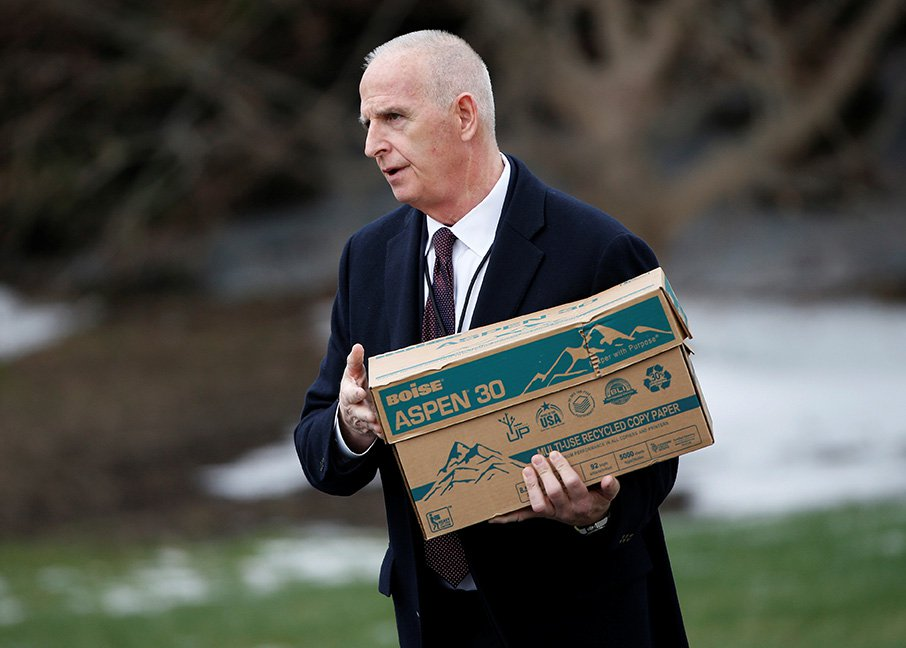 Keith Schiller, deputy assistant to the president and director of Oval Office operations, carries a box to Marine One at the White House on March 17, 2017.