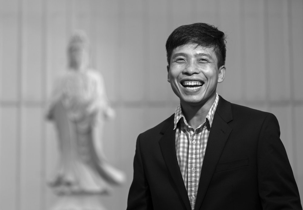 Quang Nguyen, a naturalized U.S. citizen originally from Vietnam, stands near a statue of Avalokitesvara – a bodhisattva who embodies compassion – at the Chua Hoi Duc Temple in South Portland. Nguyen was instrumental in getting the Buddhist temple established.