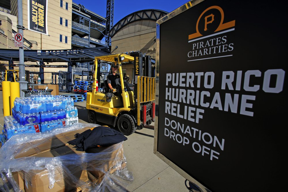 Donations pile up Monday outside PNC Park in Pittsburgh, where the Pittsburgh Pirates baseball team is collecting supplies for Puerto Rico. The U.S. government is reportedly planning to seek $10 billion to help recovery efforts in the storm-wracked U.S. territory.