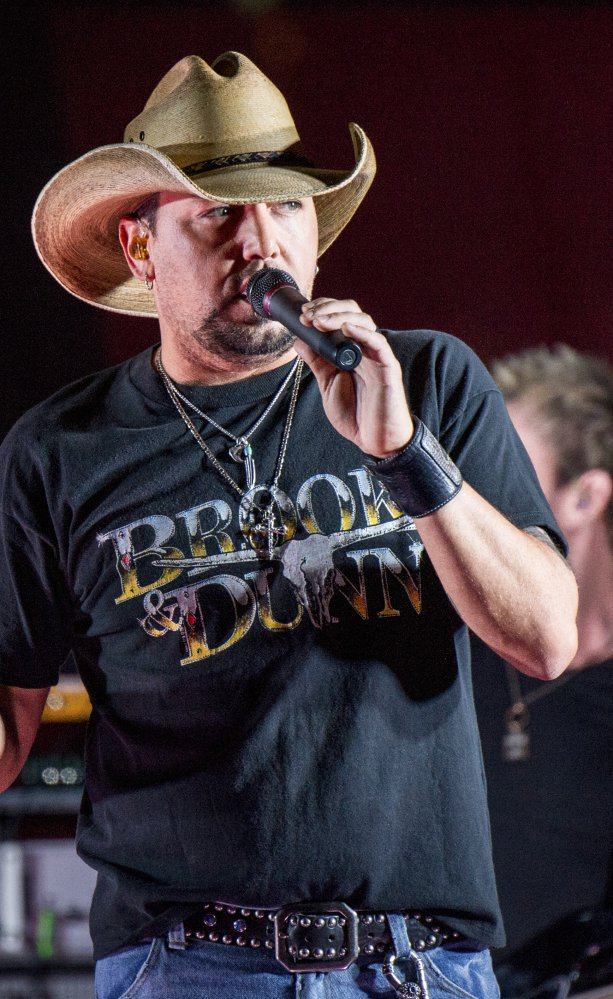 Jason Aldean performs during a surprise pop up concert on June 7 at the Music City Center in Nashville, Tenn. Aldean was the headlining performer when a gunman opened fire at a music festival on the Las Vegas Strip on Sunday, Oct. 1.