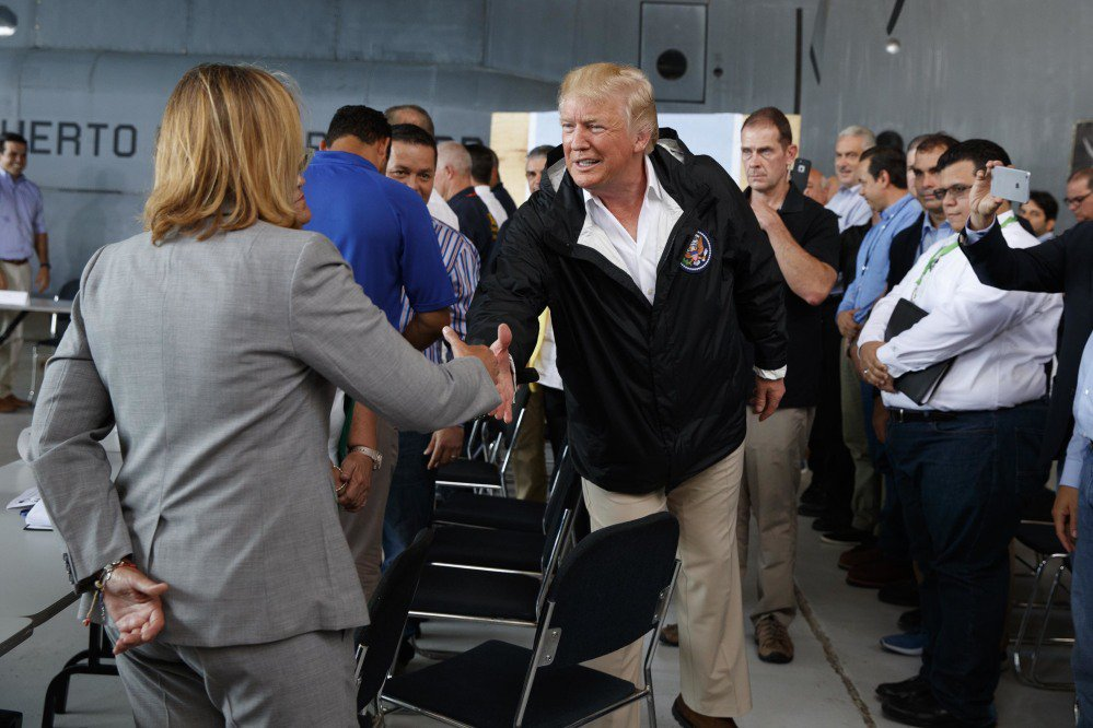 President Trump shakes hands with San Juan Mayor Carmen Yulin Cruz during a briefing on hurricane recovery efforts with first responders at Luis Muniz Air National Guard Base Tuesday in San Juan, Puerto Rico.