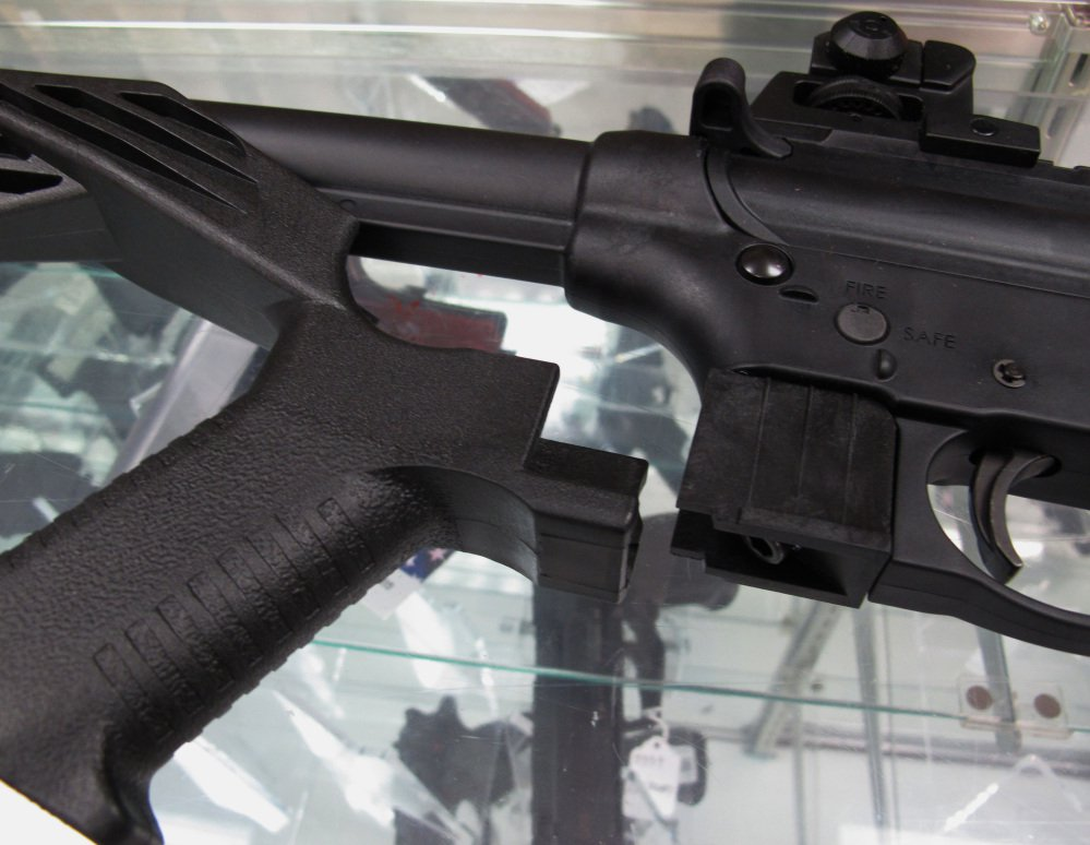 Bump stocks such as this one next to a disassembled .22-caliber rifle have been around since the government approved their sale in 2010.