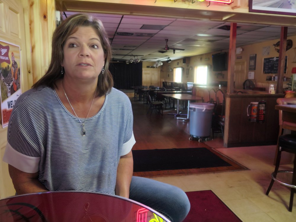 Tammy Graceffa, 54, owner of the Hiawatha Bar and Grill in Sturtevant, Wis., is pleased the new Foxconn plant will boost the economy, but she might lose the land where she grew up.