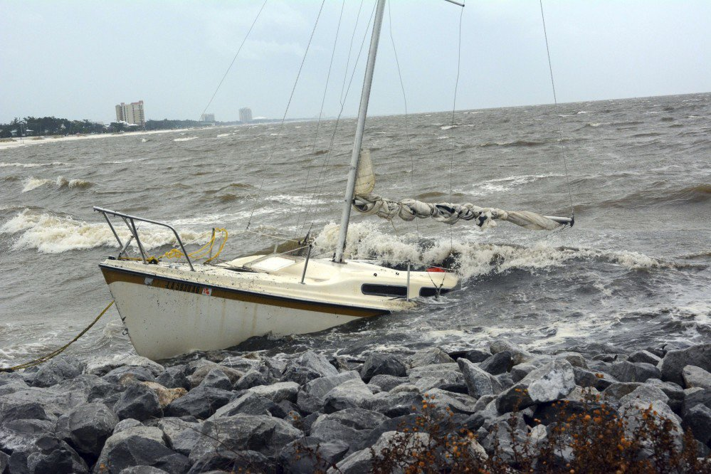 An abandoned boat takes on water on the Mississippi Gulf Coast on Saturday near Biloxi, Miss., as the outer bands of Hurricane Nate begin to batter the shore.