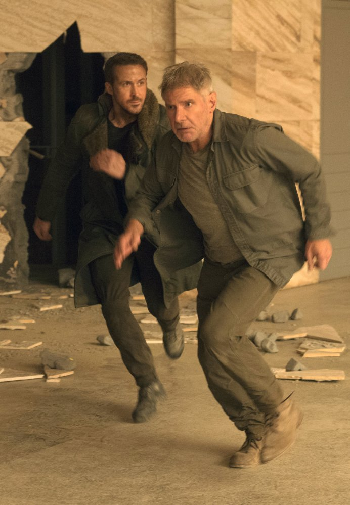 "Ryan Gosling, left, and Harrison Ford appear in a scene from ""Blade Runner 2049"" in this image released by Warner Bros. Pictures."